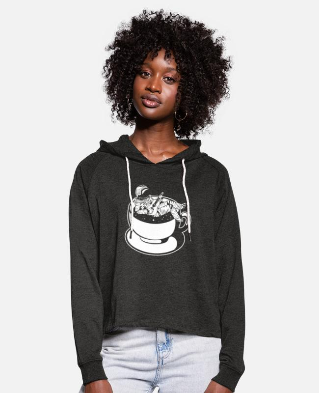 Planets Hoodies & Sweatshirts - Astronaut sits in the coffee cup and plays Gita - Women's Cropped Hoodie charcoal grey