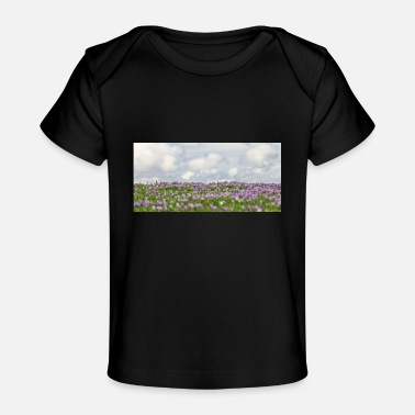 Field with wild purple crocuses with clouds i - Organic Baby T-Shirt