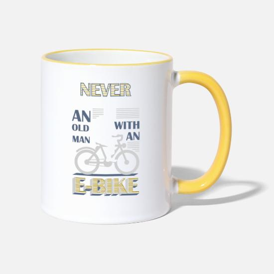 Bicycle Mugs & Drinkware - Never underestimate an old man with an EBike - Two-Tone Mug white/yellow