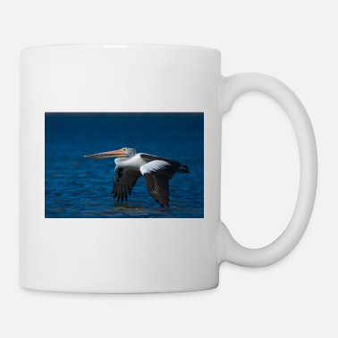 Wing A pelican flying low over the water - landscape - Mug