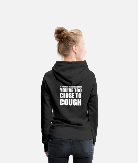 Humour Hoodies & Sweatshirts - If You Can Read This You're Too Close to Cough - Women's Premium Hoodie black