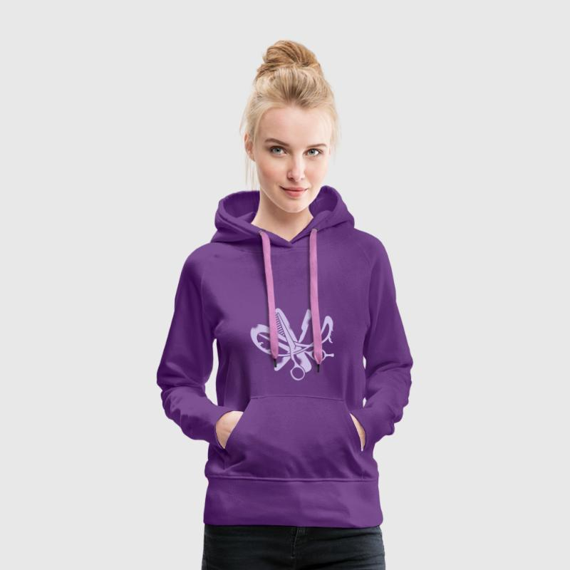 A hairdresser logo with comb, scissors and a razor - Sudadera con capucha premium para mujer