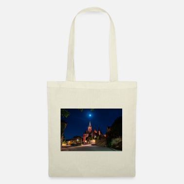 St. Catherine's Church illuminated in red with the moon - Tote Bag