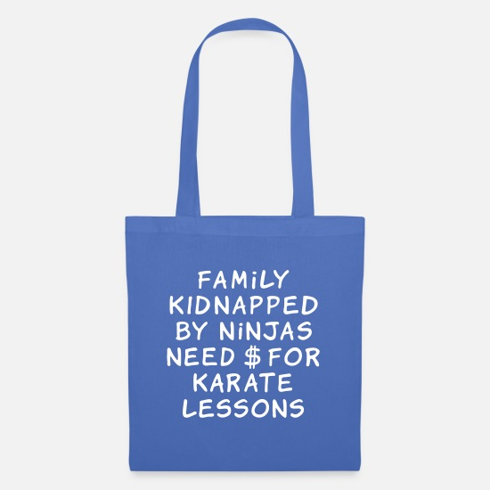 Provocative Bags & Backpacks - family kidnapped by ninjas need dollars for karate - Tote Bag light blue