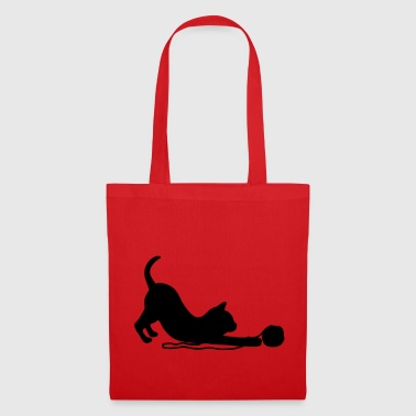 Kitten playing with a ball of wool.  - Tote Bag