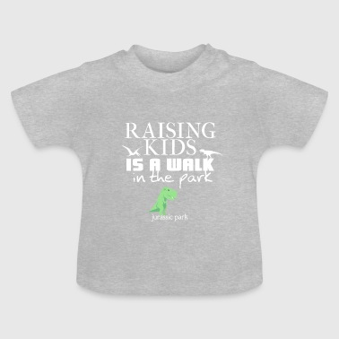 Raising kids is a walk in Jurassic park - Baby T-Shirt