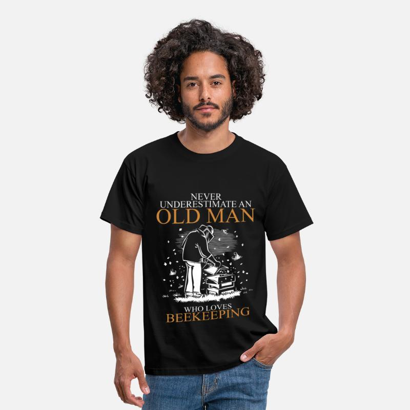 Man T-Shirts - Never Underestimate An Old Man Beekeeping.png - Men's T-Shirt black
