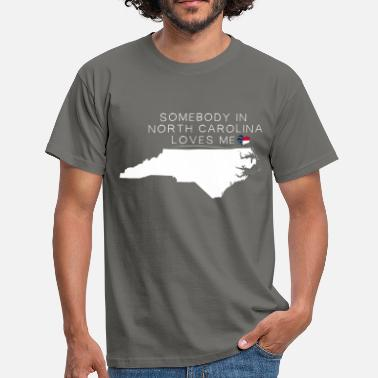 North Carolina North Carolina - Somebody in North Carolina loves  - Men's T-Shirt