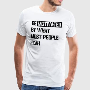Be motivated by what most people fear - Männer Premium T-Shirt