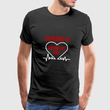 Nurse: Everyday is saving life day - Men's Premium T-Shirt