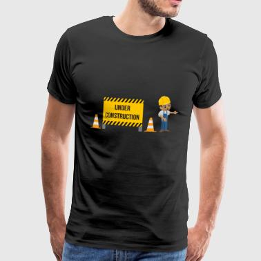 Schild Under Construction, Arbeiter zeigt links - Männer Premium T-Shirt