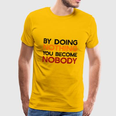 By doing nothing, you become nobody - Men's Premium T-Shirt