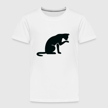 A cat licking its paw - Kids' Premium T-Shirt