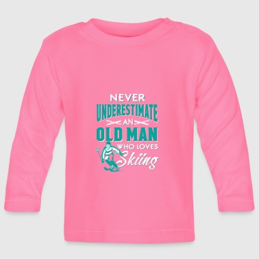 Never underestimate an old man who loves skiing  - Baby Long Sleeve T-Shirt