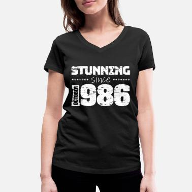 Production Year Stunning since October 1986 - Women's Organic V-Neck T-Shirt