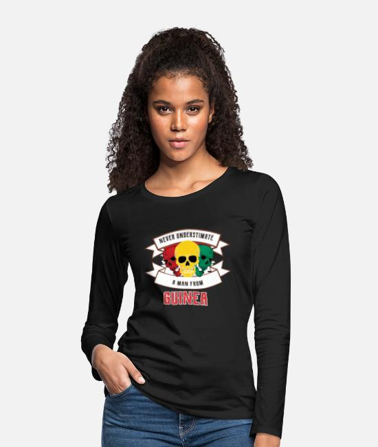 Travel Long Sleeve Shirts - Never underestimate someone from Guinea - Women's Premium Longsleeve Shirt black