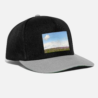 Field with wild purple crocuses with clouds i - Snapback Cap