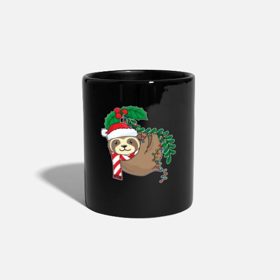 Gift Idea Mugs & Drinkware - Sloth hangs with mistletoe cap on mistletoe - Mug black