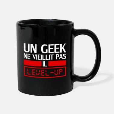 Anniversaire un geek ne vieillit pas il level up - Mug