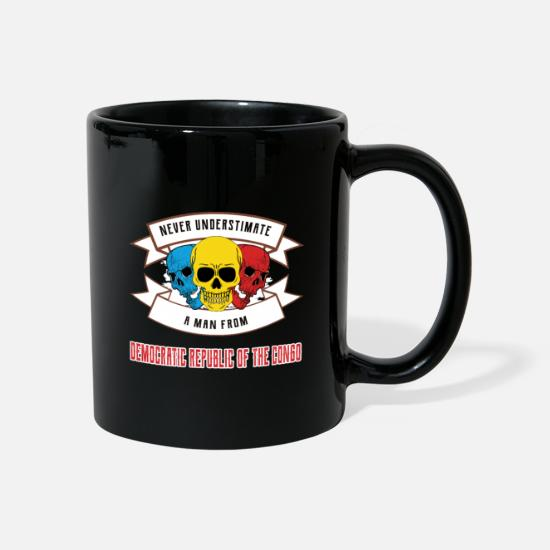Travel Mugs & Drinkware - Never underestimate anyone from the Democratic Republic - Mug black