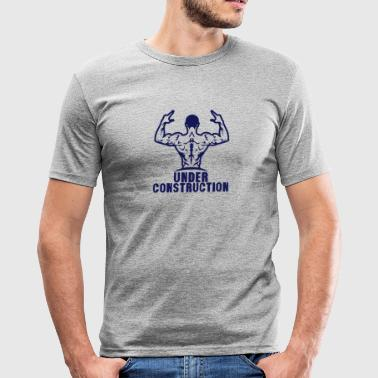 Under construction bodybuilding logo mus - Men's Slim Fit T-Shirt