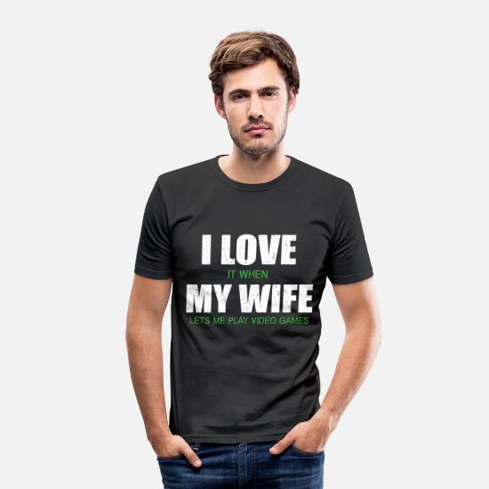 My T-Shirts - I LOVE IT WHEN MY WIFE LETS ME PLAY GAMES  - Men's Slim Fit T-Shirt black
