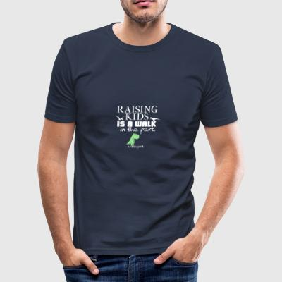 Raising kids is a walk in Jurassic park - Männer Slim Fit T-Shirt
