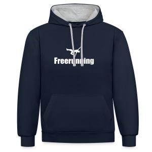 Kontrast-Hoodie - Mit dem Kauf dieses Shirts unterstützen sie den Freerunningpark St. Pölten. Mit jedem gekauften Shirt geht eine 5 Euro-Spende an die Austrian Freestyle Federation, die sich um die Instandhaltung und Wartung kümmert und sich für zukünftige Erweiterungen und Verbesserungen engagiert.