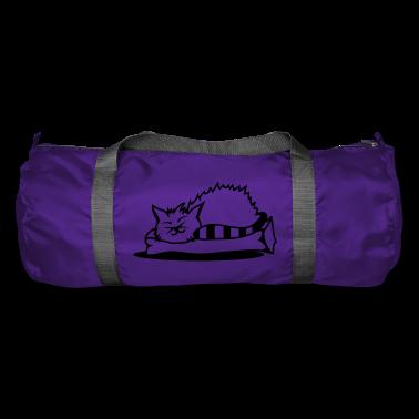 A cat sleeps on a pillow Bags