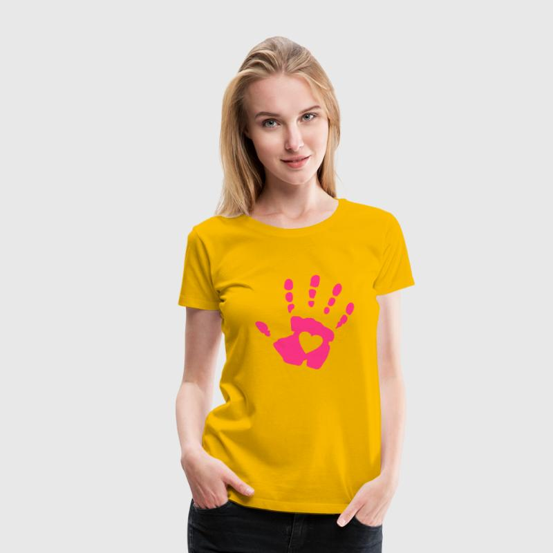 Yellow heart in handprint Women's T-Shirts - Women's Premium T-Shirt
