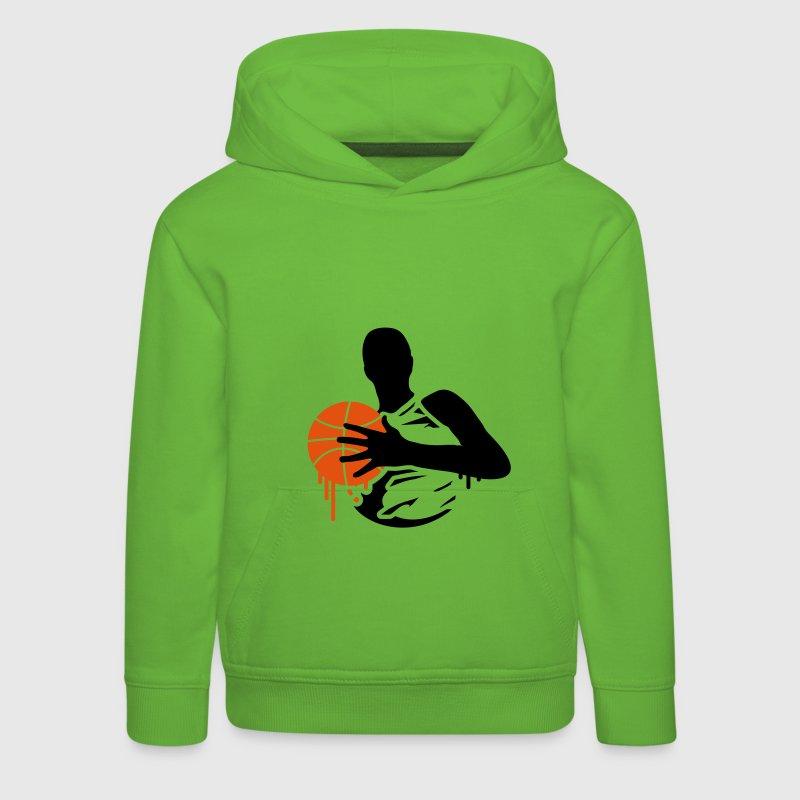 Un joueur de basket avec un ballon de basket Sweats Enfants - Pull à capuche Premium Enfant