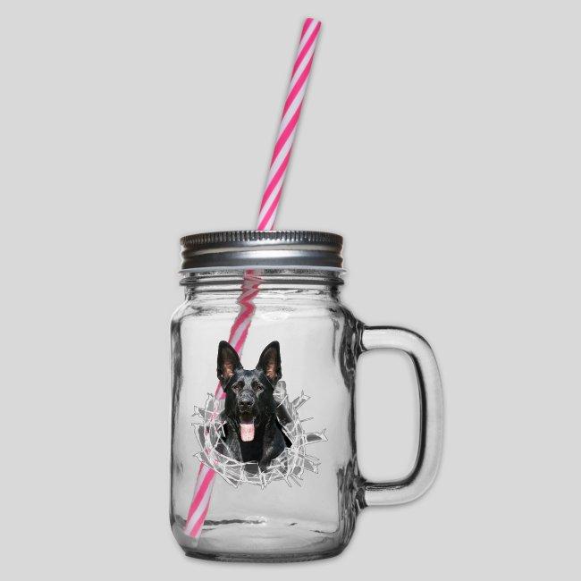 Schwarzer Schäferhund im Glas Loch