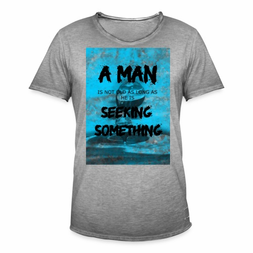A man is not old as long as he is seeking somethin - T-shirt vintage Homme