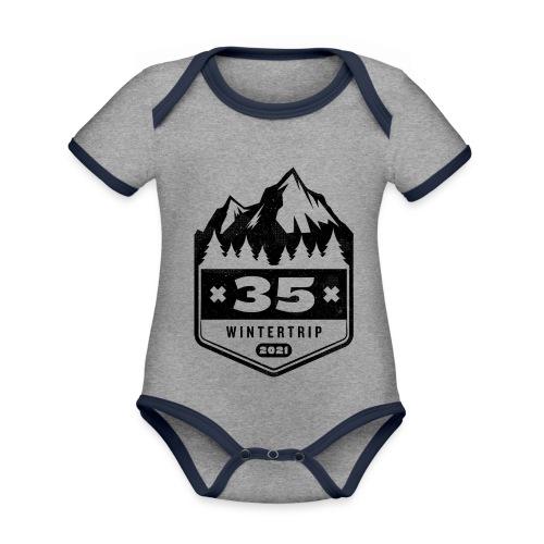 35 ✕ WINTERTRIP ✕ 2021 • BLACK - Baby contrasterend bio-rompertje met korte mouwen