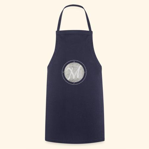 Montis logo - Förkläde