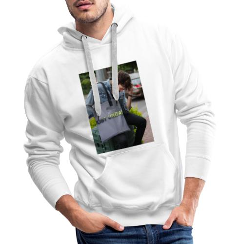 man carrying a tote bag mockup while looking to th - Men's Premium Hoodie