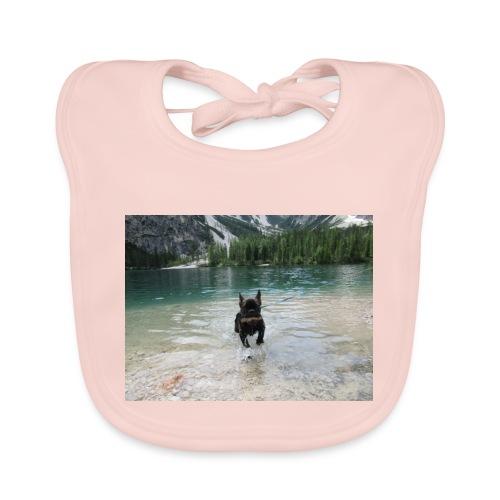 Hund spielt im Wasser - Baby Bio-Lätzchen