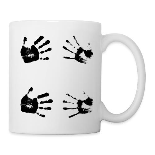 Schwarze Handabdrücke. Geschenk - Tazza