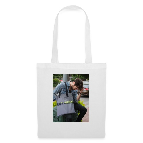 man carrying a tote bag mockup while looking to th - Tote Bag