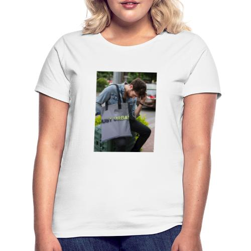 man carrying a tote bag mockup while looking to th - Women's T-Shirt