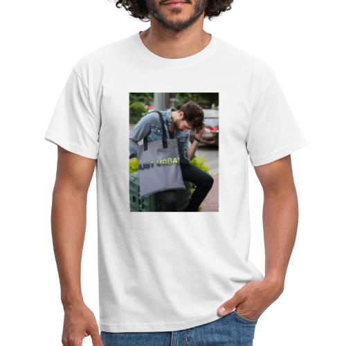 man carrying a tote bag mockup while looking to th - Men's T-Shirt
