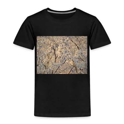 Aurinko pilkistää oksien ja lumen läpi - Lasten premium t-paita