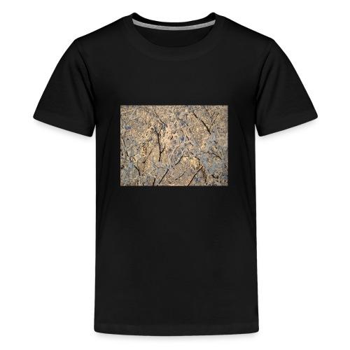Aurinko pilkistää oksien ja lumen läpi - Teinien premium t-paita