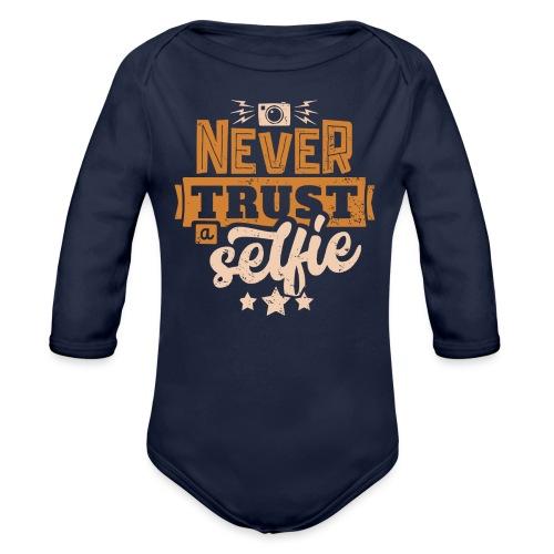 Never trust - Ekologisk långärmad babybody