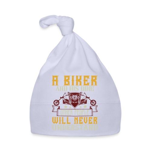 A biker and his bike. - Baby Cap