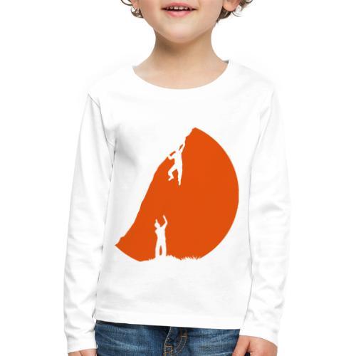 Boulderer mit Spotter im Sonnenuntergang - Kinder Premium Langarmshirt