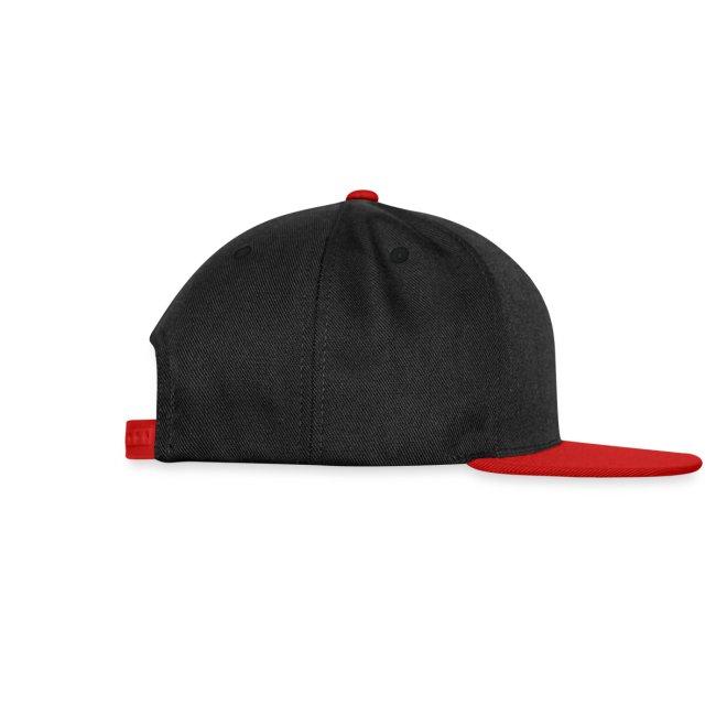 Black Kitten Under Tire on Cap