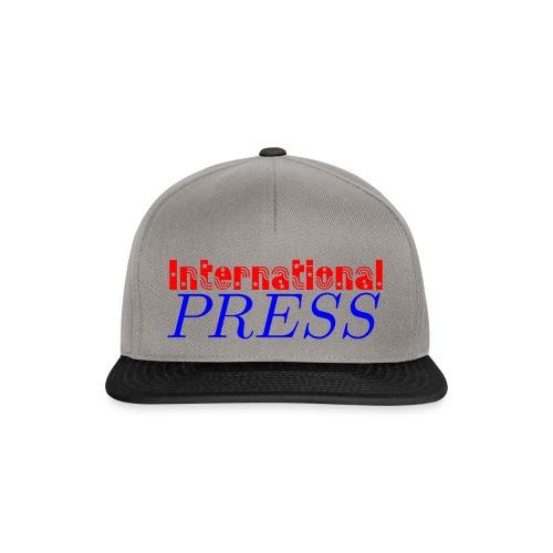 int_press-png - Snapback Cap