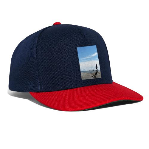 Stefan riding rocks by the sea with shadow logo - Snapbackkeps